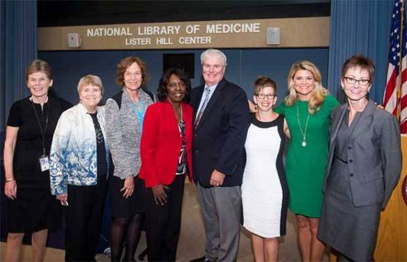 At the September 17, 2015 opening event, NLM Acting Director Betsy Humphreys (l.) joins (l. to r.) nurses Dr. Barbara Parker, Dr. Jacquelyn Campbell, Dr. Doris Campbell and Dr. Daniel Sheridan, along with exhibition curator Dr. Catherine Jacquet, ABC7's Kimberly Suiters, and Patricia Tuohy, head of the Exhibition Program, NLM History of Medicine Division.